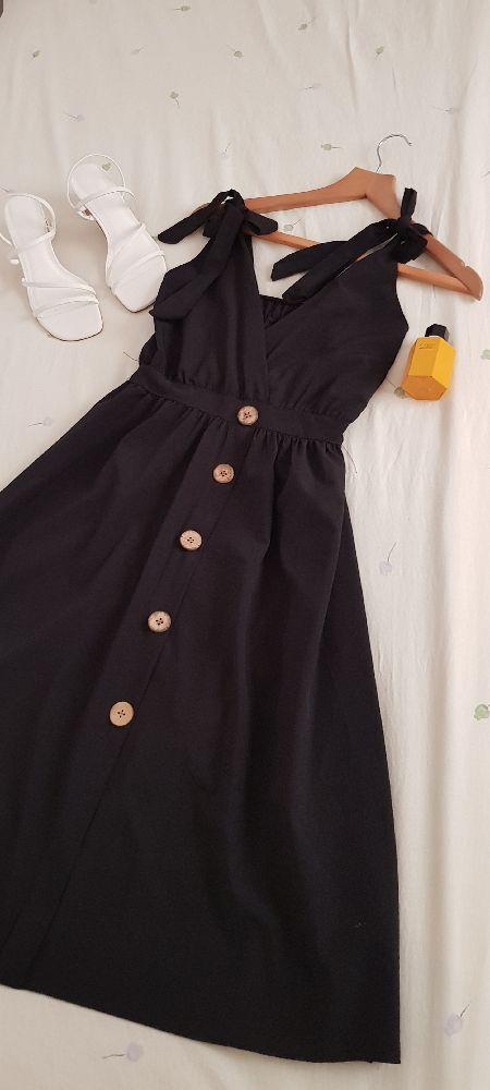 Robe noir mi longue à bretelle nœud